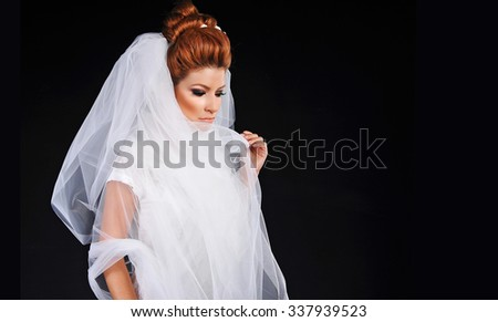 women in white wedding dress at black background