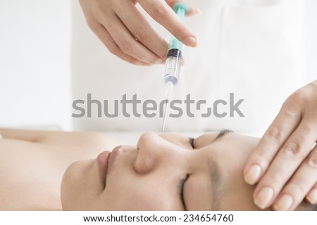 Women injected the cosmetic ingredients to the nose - stock photo