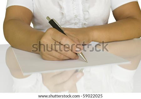 women keep pen and write on the white page with reflection - stock photo