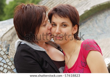 women kiss outdoor - stock photo