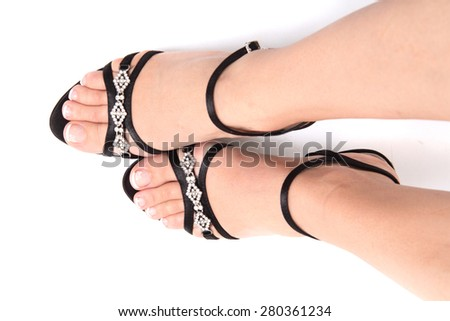 women legs in the black shoes isolated on the white background - stock photo