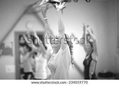 Women lifting arms  in fitness class - stock photo