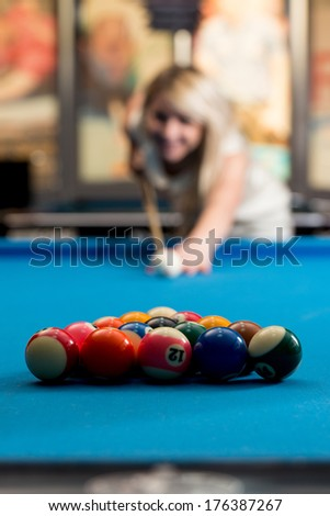 Women Lining Ball Up To Break In Pool