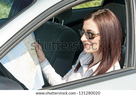 women looking for way in the car - stock photo