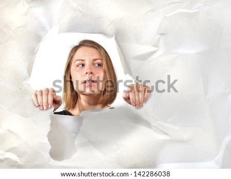 Women looking through a hole. Looking mystified - stock photo