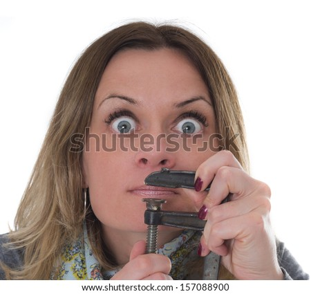 women needs to shut up, she holding a clamp on her mouth - stock photo