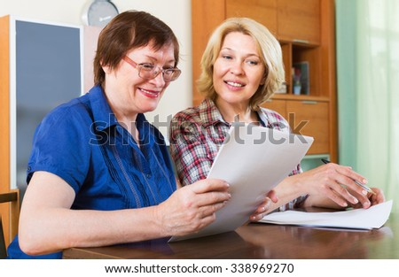 Women notary officer helping client drawing up of will - stock photo