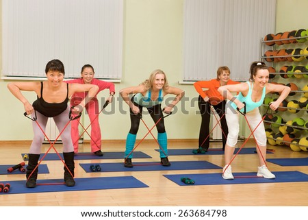 Women of Different Age Doing Aerobics with Dumbbells - stock photo