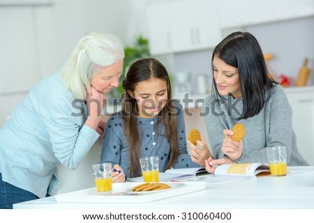Women of the family gathered in the kitchen - stock photo
