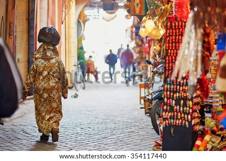 Women on Moroccan market (souk) in Marrakech, Morocco - stock photo