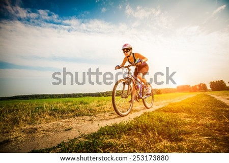 Women on the nature of riding a bike - stock photo