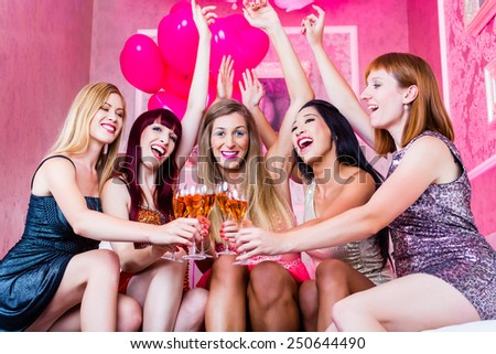 Women partying with champagne in night club  - stock photo
