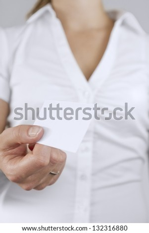 Women passing a business card.
