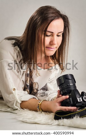 Women photographer with DSLR camera