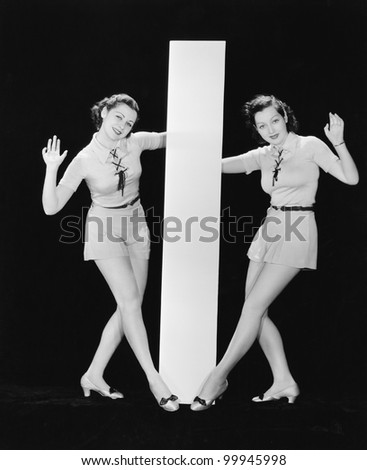 Women posing with big letter I - stock photo