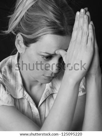 women praying in darkness - stock photo