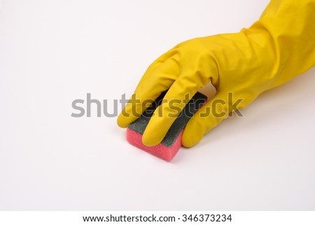 women protecting hand with rubber glove from detergents as they use a cleaning sponge  on white background - stock photo