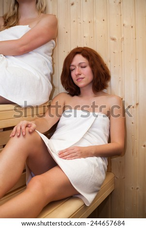 Women relaxing in sauna. - stock photo