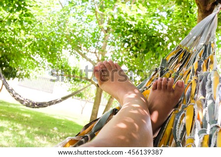 Women relaxing lying in Hammock with nature background.