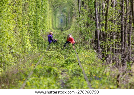 Women rest on the rails in the tunel of love. Klevan. Ukraine. - stock photo