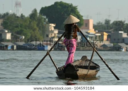 Women rowing boat at Mekong delta - stock photo