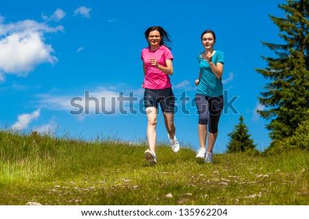 Women running - stock photo