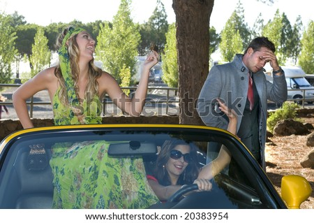 women running in an sport car with a credit card of a desolated man - stock photo