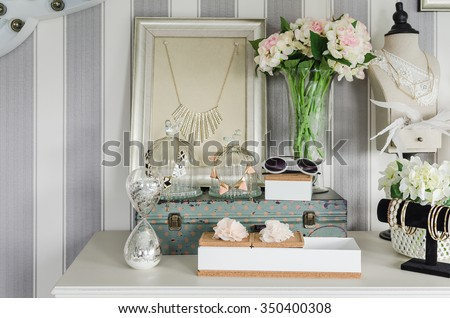 women's accesories on white dressing table at home - stock photo