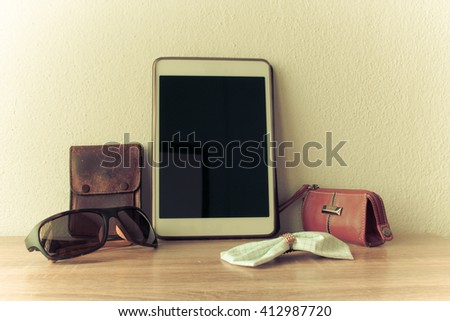 Women's  accessories,Wallet, sunglasses, hair clips, tablets on wood background