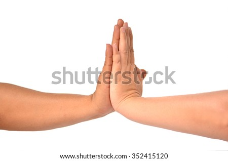 women's and men's hand touching on a white background - stock photo