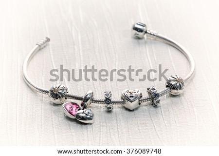 Women's Bracelet Pandora, Charms close-up, jewelry, retro style - stock photo