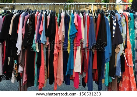 Women's casual summer clothes for sale at street market.