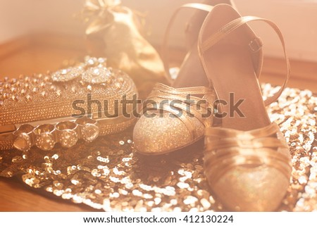 Women's clothes and accessories. Golden. Fashion Shoes. Expensive Luxury jewelry close-up background. Shiny Crystal Precious Gem Jewels - stock photo