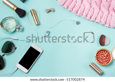 women's clothes on the turquoise background, layout female table