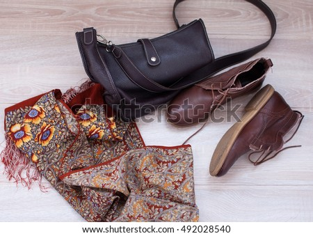 Women's clothing and accessories. Scarf and brown boots