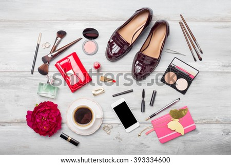 Women's fashion and beauty objects and accessories on wooden floor - stock photo