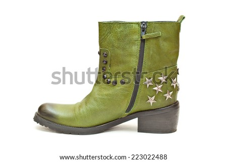 Women's fashion boots green in cowboy style. Autumn - spring leather shoes with studs and stars - stock photo