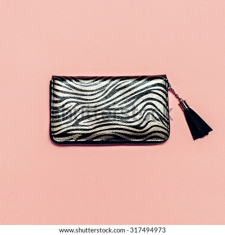 Women's Fashion Clutch on pink background