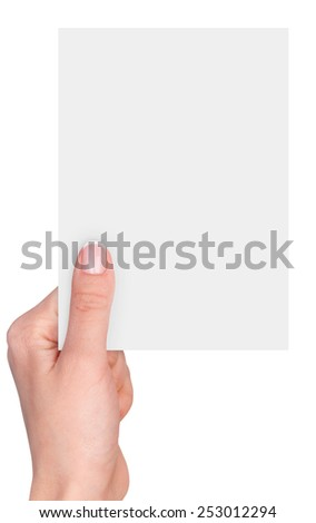 Women's fingers holding a blank business card isolated on white background
