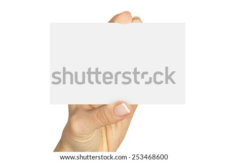 Women's fingers holding a blank business card isolated on white background  - stock photo