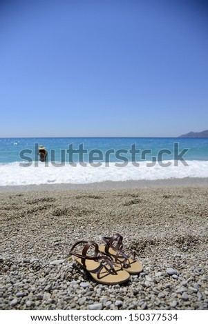 Women`s flat shoes on the pebble - stock photo
