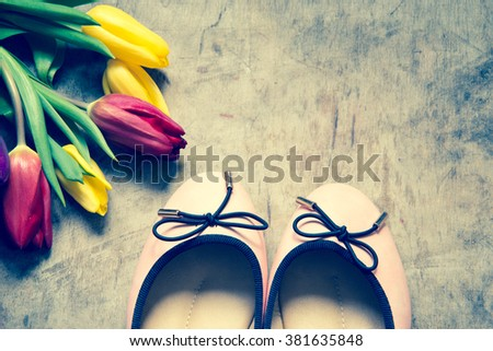 Women's flats shoes and tulips/toned photo - stock photo