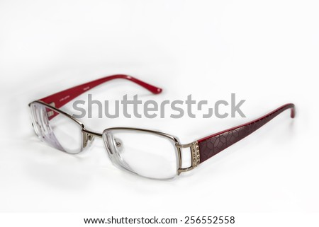 women's glasses in an elegant rimmed on a light background - stock photo