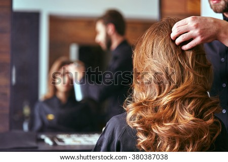 Women's haircut. hairdresser, beauty salon - stock photo