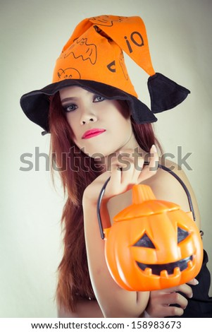 Women's Halloween hat and pumpkin in concept halloween