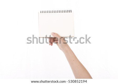 women's hand holding a blank sign