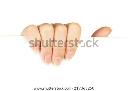 Women's hand holding a white sheet of paper
