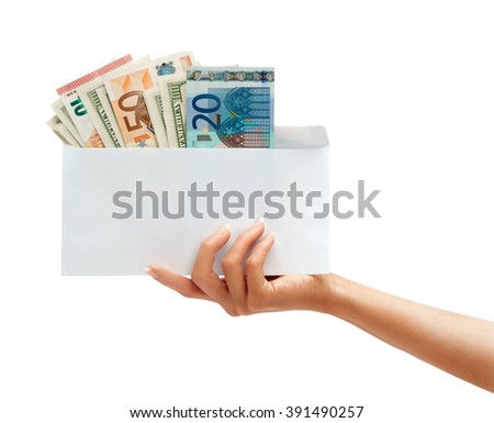 Women's hand holding out an envelope full of euro and dollars. Business concept