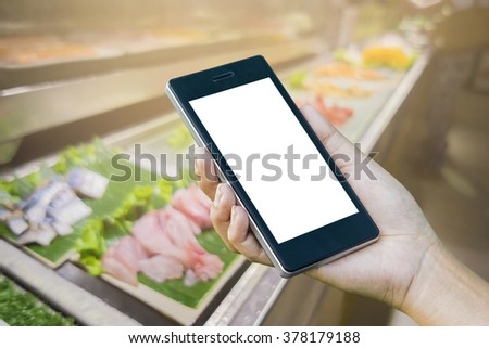 Women â??s Hand holding smart phone with food online device on screen over blur  japanese food restaurant background, food online, food delivery concept - stock photo