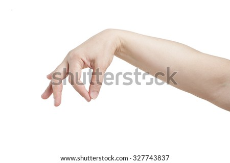 Women's hand holds something on a white background.